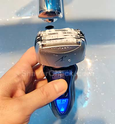Cleaning the shaver with soap and water.