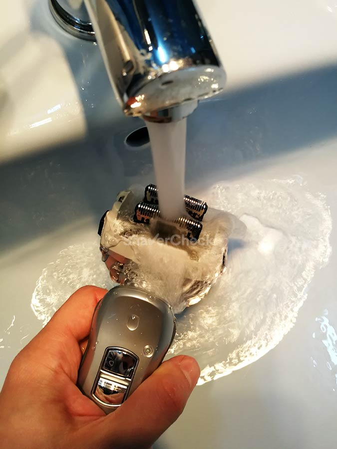 Rinsing the inner blades of a Panasonic shaver with tap water