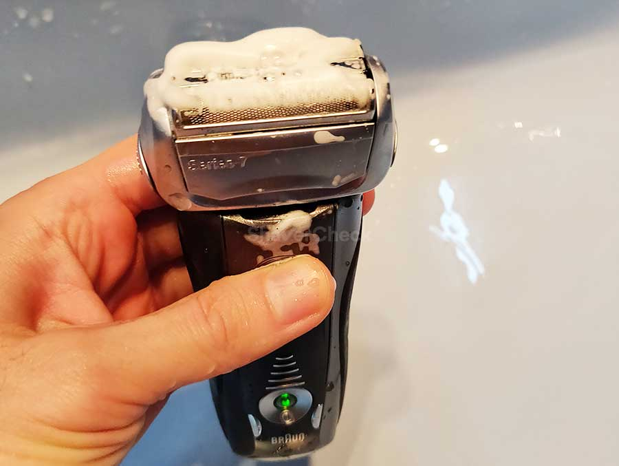 Turning on the shaver to lather the soap