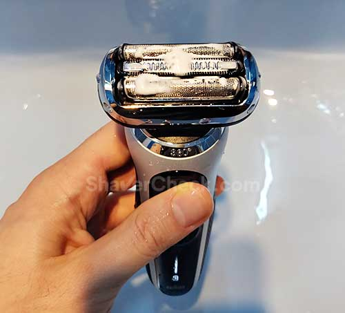 Cleaning the shaver with liquid soap.