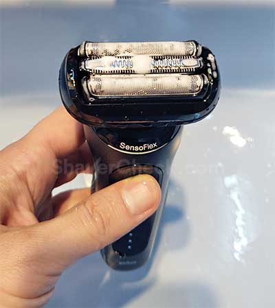 Cleaning the shaver with water and liquid soap.